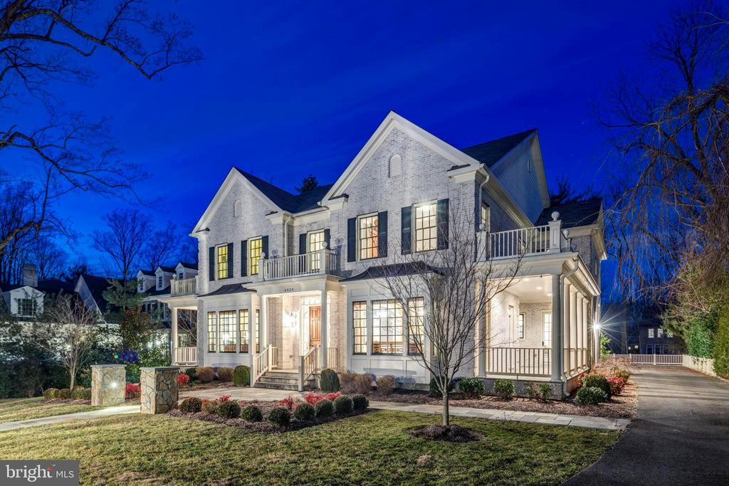 This Middleburg built all brick and stone colonial is handsomely sited on a half acre in one of McLean's most sought after neighborhoods. This meticulously maintained home was built with exceptional detail in mind and shows like a model home.  Special features include over 7500 sf of living space, ten foot ceilings on the main level, three fireplaces, a whole house generator, a three car garage with a finished suite above, walkout lower level with au pair suite and multiple porches. The gallery foyer is flanked by the living and dining rooms with arched entrance features and French doors to side porches. The study is privately located off the foyer with a wall of built-ins.  The expansive family room has walls of windows, a gas stone fireplace and coffered ceilings. The gourmet kitchen features Jenn-Air appliances and a large center island and adjoining breakfast room with communication center. The butlers pantry includes a wine rack and refreshment refrigerator. There are hardwood floors throughout the main level and the upper level hallway and master suite.  The master suite includes a sitting room with gas fireplace and luxurious bathroom.  There are three additional bedrooms with private baths and all bedrooms have plantation shutters.  The walkout lower level has an expansive recreation room, guest suite with full bath, office, media/theater room, half bath, full bar with kitchenette and wine room. Langley Forest is ideally located minutes to 495 and Tysons Business Center and equal distances to Reagan and Dulles International Airports as well as the Dulles Tech Corridor and the new National Landing, future home of Amazon HQ2.  Just blocks to Scott's Run Nature Preserve.
