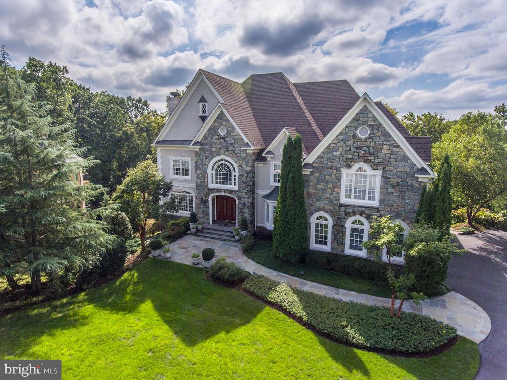 Custom French County Style w/ 9,500+sqft. Premium Golf Course lot-stunning views.  6 BD/7BA w/ elevator. Grand 2-Story Foyer, 4 fireplaces, LRG office, sunroom & 2-story Fam Room. Kitchen renovation 2019 includes Subzero, Wolf & Miele Appliances, 5~ wood floors, quartz counters, dove white cabinets & butler~s pantry. Expansive Master Suite w/ Sitting Room, wet bar, private upper terrace & Luxurious private bath w/ Marble Flooring, Separate Vanities, Frameless Glass Walk-in Shower, Soaking Spa Tub, His and Hers Water Closets. LL great for entertaining w/ LRG rec area, exercise room, wine cellar, billiards area and putting green!!! 3-Car Oversized Garage w/ personal cart access to golf club.  Great proximity to Seneca, Great Falls & Algonquin Parks and walking trails.