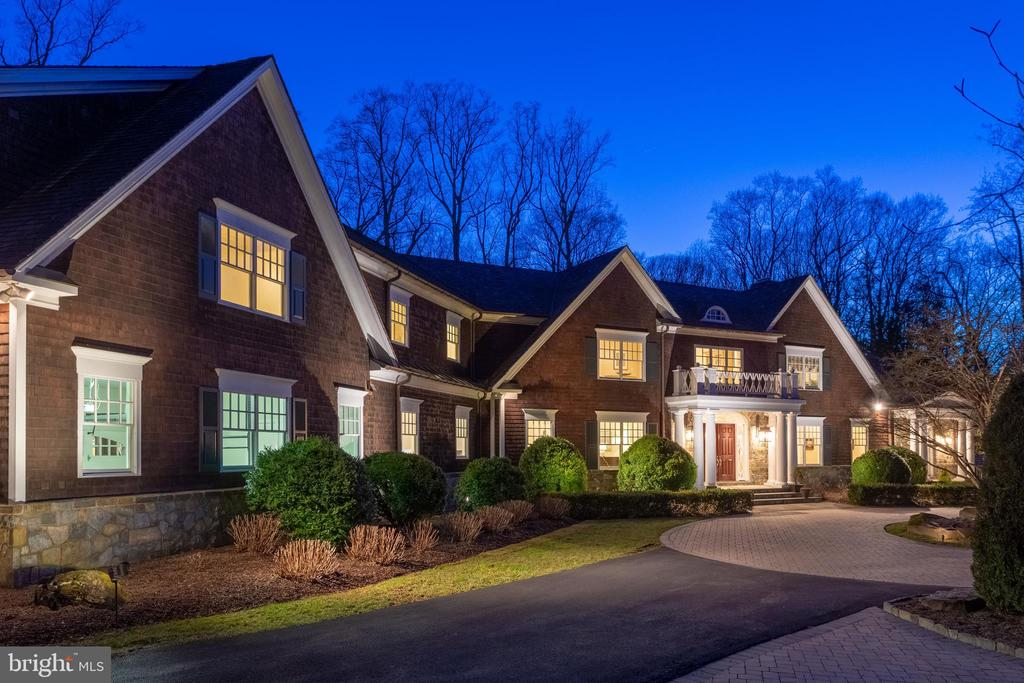 """Price reduced on this one of a kind home! NOTE: The detached carriage house has an additional bedroom and full bath for a total of 7 bedrooms/8 full baths/2 half baths. The Hamptons meet Northern Virginia in this one-of-a-kind cedar shake house. Significantly renovated in 2018 by BOWA, this home offers a rare combination of perfect space (not too little but not too much), spectacular architecture/updating/finishes, a beautiful, private lot, and the best part? A fantastic location inside the beltway. This is the perfect indoor/outdoor entertaining home with 6 main level rooms that open to the flagstone patio. The family room has a folding window that fully opens to serve as a food/beverage pass through to the patio. The brand new screened in porch w/fireplace provides a comfortable area to appreciate the yard and pool while relaxing. The yard and the 20'X50' heated pool are on the main living level so entertaining access is that much more convenient. The current owners spared NO expense in renovating this already gorgeous house and you truly must see it to believe it. One example of the brilliant remodeling is the master suite.  It was reconfigured to create 2 separate master baths and 2 master closets plus a built in Miele coffee """"good morning"""" station. The attention to detail is extraordinary and must be seen in person to truly be appreciated."""