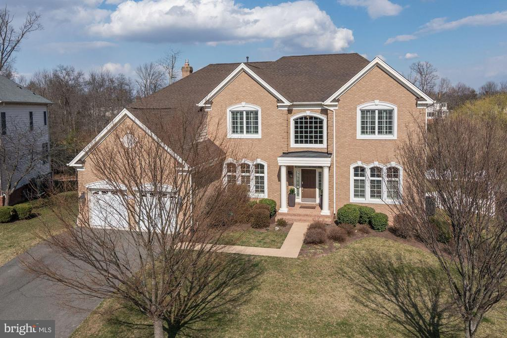 Absolutely Stunning Somerset Model with Solarium in Belmont Country Club! This is a Rare Opportunity to be in Loudoun Counties Premiere Country Club Community in an Estate Home that is on the Golf Course and also has a Fenced Back Yard! The Interior features are vast and include a Grand Two Story Foyer with a Curved Staircase, a Two Story Family Room with a Floor to Ceiling Stone Fireplace, the Gourmet Kitchen has Stainless Steel Appliances and Granite Countertops. The Spacious Master Suite boasts Coffered Ceilings, His & Her Walk in Closets, and a Luxury Master Bath with a Soaking Tub. So many Upgrades Including a Laundry Room with Built in Cabinetry and Heated Floors, a large Custom Mud Room, Plantation Shutters Throughout, Custom Doors with Frosted Glass. the Oversized 2 Car Garage has Epoxy Flooring and a Tesla Charging Station. Enjoy the Panoramic Views of the Arnold Palmer Signature Course and Pond from your Multi-tiered Custom Trex Deck with Clear View Balusters and Lighting while Overlooking your Fully Fenced Park Like and Flat Back Yard.  This Estate Home is Truly Unique and Incredible! Belmont Country Club Amenities Include Full Lawn & Landscape Maintenance, High Speed Internet, CableTV, Pools, Tennis, Basketball, Volleyball, Playgrounds, Walking Trails & the Historic Belmont Manor Home. All Residents Enjoy The Use of The Country Club for Dining/Entertaining & All Social Events.