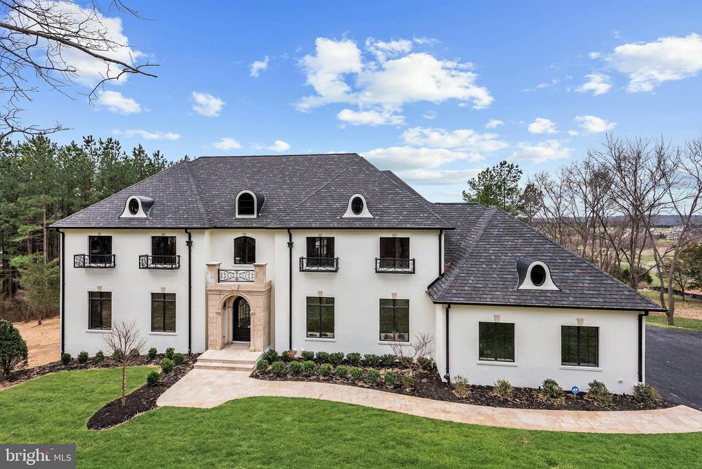 French-inspired elegance has met modern luxury in this newly completed estate residence. Sited on one of the best sites in Creighton Farms, this custom residence captures panoramic views of the Blue Ridge Mountains and beyond. The residence has been thoughtfully designed to accommodate generous entertaining as well as comfortable day to day living.  Rich marble, polished brass, nickel, and custom millwork are just a few of the stunning finishes throughout.  On the main level, a grand entry hall welcomes guests and opens to a dramatic, two-story great room opening to an expansive terrace with sublime views of the mountains beyond.  Adjacent to the great room, a stunning chef's kitchen is appointed with top of the line appliances, abundant custom cabinetry, and a dramatic, custom range hood.  An illuminated custom wine room compliments the offering and is ideally located just off the kitchen.  To complete this level, the residence features a luxurious master suite with a chic gas fireplace, large walk-in closets, and a truly luxurious master bath.  Upstairs, three additional bedrooms are complimented with ensuite baths.  The lower level reveals additional surprises.  This is the perfect place for entertaining and features an expansive wet bar, fireplace, and space to accommodate a home theater as well as other amenities.  A security gate at the entrance to this prestigious community as well as concierge services afford both peace of mind and convenience.  Shown by appointment only with 24 hrs notice.