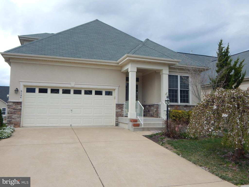Move In Condition. Freshly painted in  soft neutral greys. New carpet! Main level hardwood floors except bedrooms. Spacious 3 level home.  Open loft over living room. Upgraded thru out. Large unfinished basement with w/o. Cul-de-sac location.