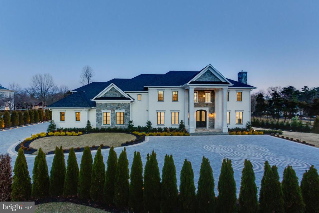 Inspired by great European manor homes, this spectacular new estate is ideally located in prestigious Langley Farms, just minutes from Washington. Developed by world-class, ALM Builders, the estate features three finely finished levels and every conceivable luxury including a grand chef's kitchen, elevator, Italian cabinetry, custom Murano chandeliers, pool, cinema, luxurious spa, and more.