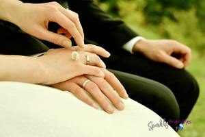7 different ways to spoil your Valentine without flowers, wedding couple holding hands with wedding rings centre of pic