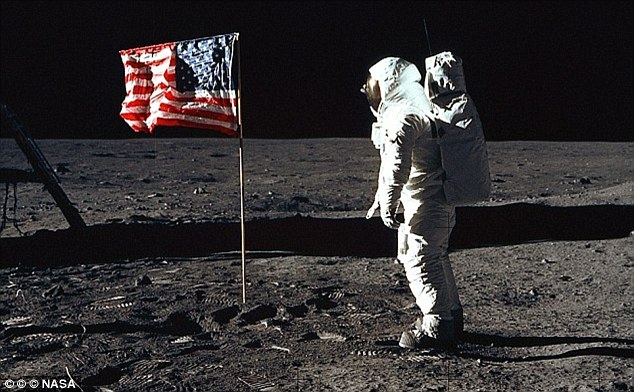 Buzz Aldrin places the U.S. flag on the moon. But is it real?