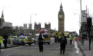 A police officer was stabbed as a man ploughed his car into a crowd of people outside Houses of Parliament in London
