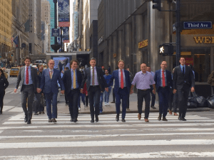 Dutch politicians cross a road in New York holding hands