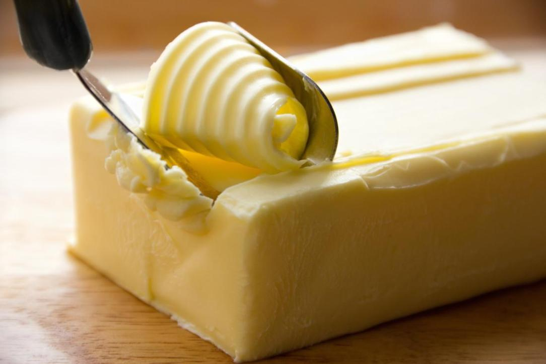 close-up-of-block-of-butter-being-sliced-may-raise-cholesterol