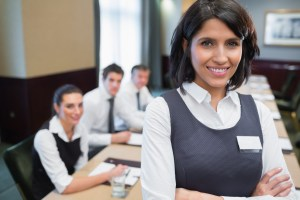 Happy businesswoman standing at meeting