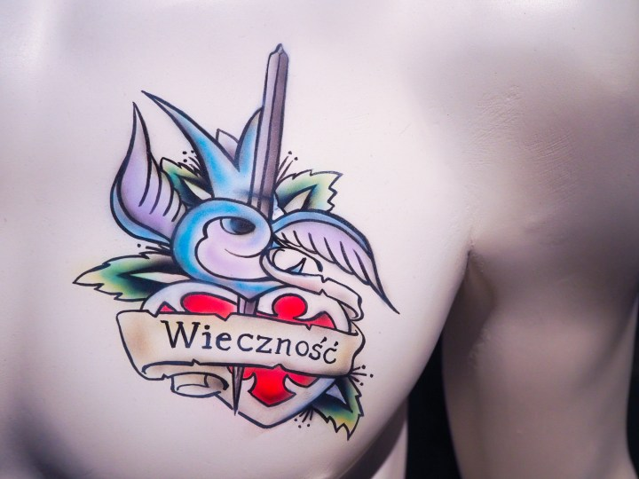A bust featuring tattoo art work.