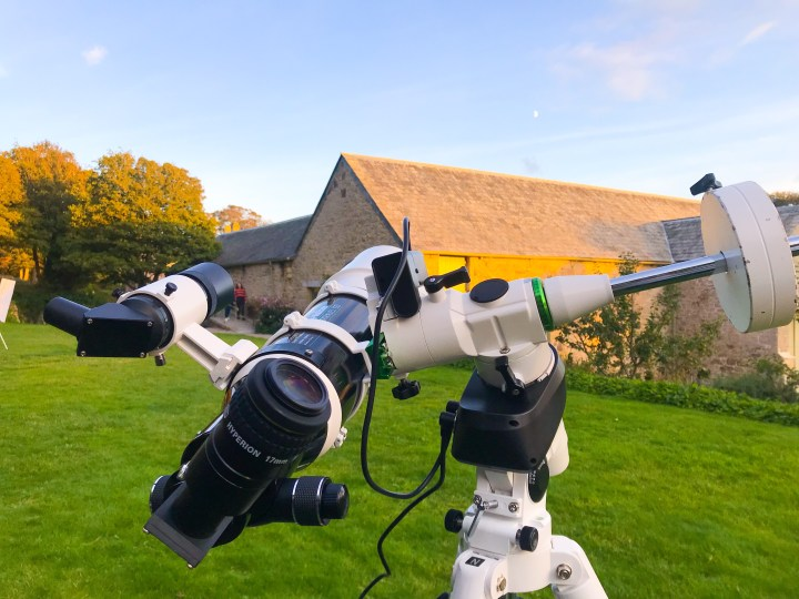 A big white telescope on the green - it's directed to track the moon.