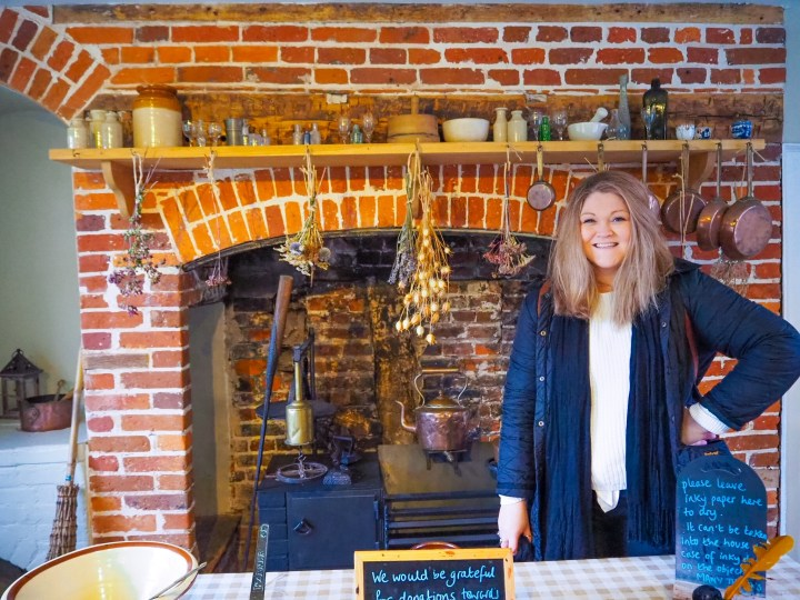 Bex stood in Jane Austen's kitchen by the fireplace
