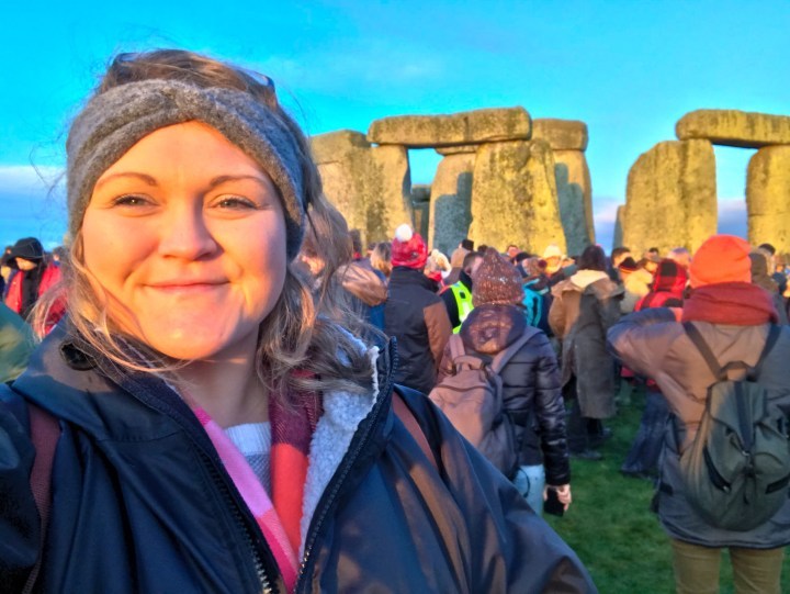 Bex from Bright Lights Big City wearing her long sleeve dryrobe at Stonehenge in Wiltshire.