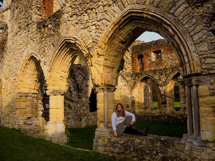 Bex sat in the arch of Netley Abbey in Southampton, Hampshire