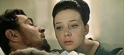 Savelyeva and Tikhonov as Natasha and Andrei in scene at his deathbed