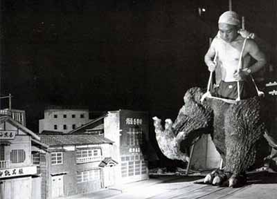 """A man in a giant lizard costume stomp across a toy replica of Tokyo"": Gojira"