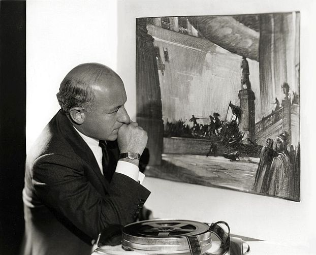 Cecil B. DeMille posed with a concept painting made by Harold Miles.