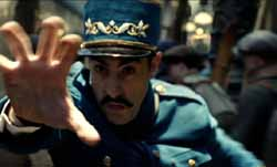 Sacha Baron Cohen as the inspector