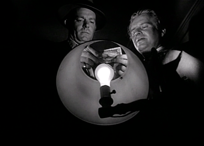 Robert Cummings and Wallace Ford in Reign of Terror, aka The Black Book