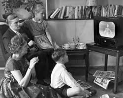 Family watching TV in the early 1950s