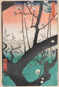 Tree with blossom in foreground, behind more trees in blossom with figures in the background. The sky is pink.