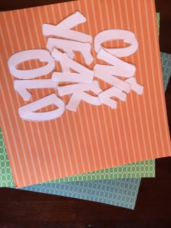 Cut-out letters on the colored paper