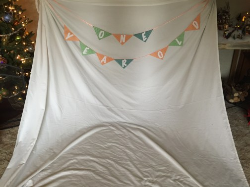 Birthday banner on a plain white sheet.