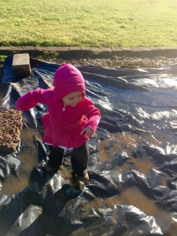 I took too long pulling one stubborn weed, and of course she found some lovely puddles.