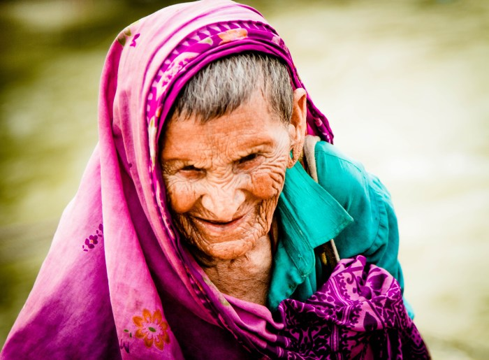 STREET PHOTOGRAPHY IMAGE OF A 100 YEAR OLD WOMAN SHOT BY BRIJESH KAPOOR IN EASTMAN COLOR FILM. THE IMAGE SHOWS THE WRINKLES ON HER FACE