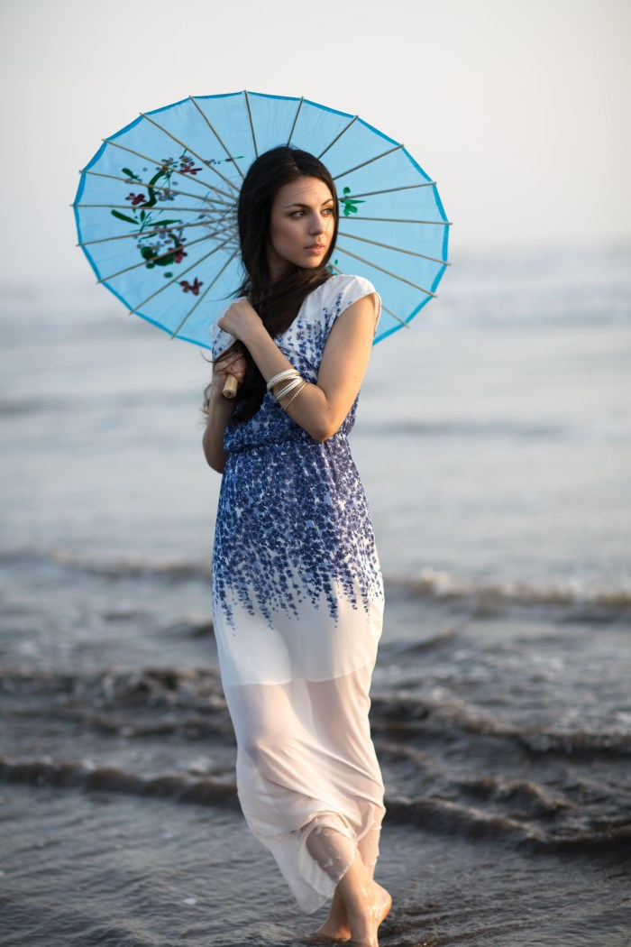 GERMAN MODEL IN A FASHION CAMPAIGN SHOOT WEARING A WHITE AND BLUE DRESS WITH A BLUE UMBRELLA SHOT BY BRIJESH KAPOOR PHOTOGRAPHY