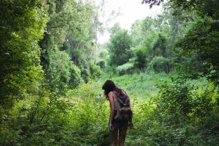 woman walking in wilds