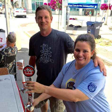 Matt Curreri of Beer house with a volunteer pourer dispensing a sample of Ei8gh Ball's red ale.