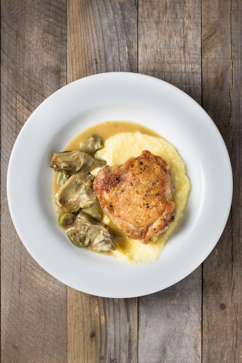 Braised Chicken Thighs & Artichokes with Polenta | Brinasbites.com @Brina's Bites