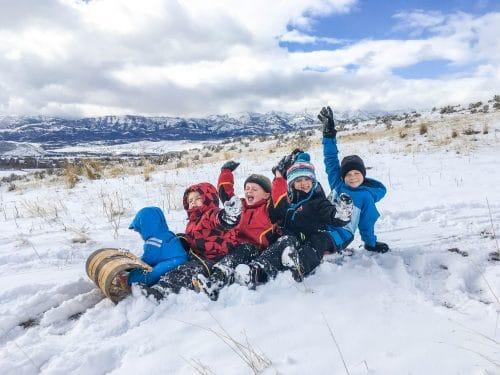 5 kids on a taboggan sledding together