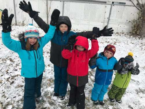 kids in snow with gloves and mittens on