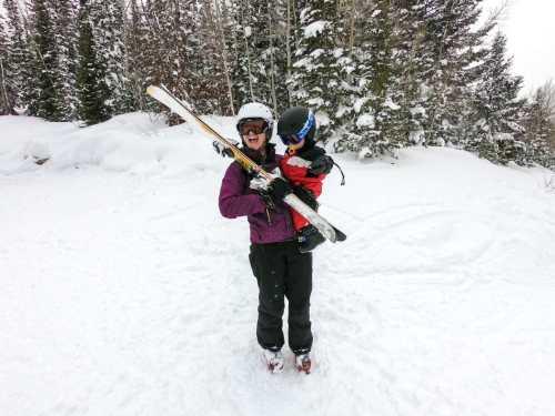 holding baby while ski