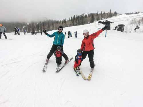 two babies skiing