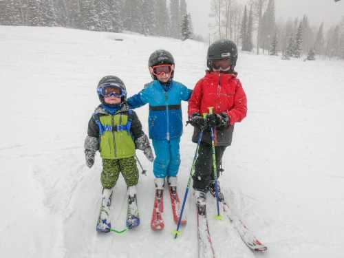 little boys skiing together