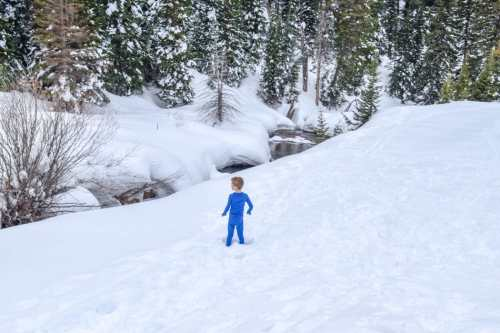 boy playing in the snow wearing base layers
