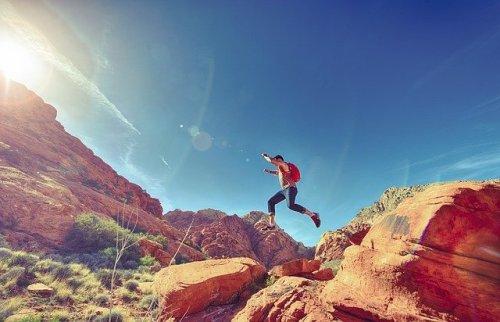 Boy jumping over rocks