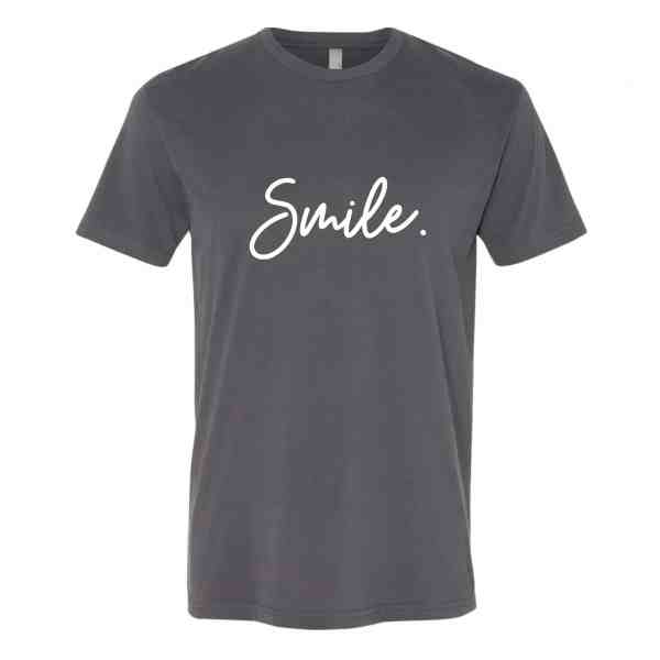 A heavy metal gray shirt with Smile written in white cursive font