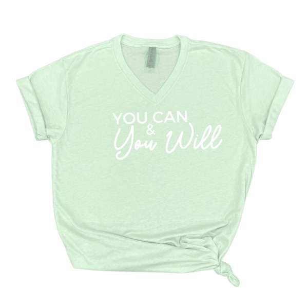 Solid white background with mint green vneck shirt that says you can and you will in white text