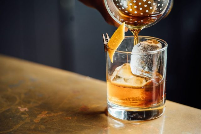 A Whisky old fashioned cocktail being poured at Christmas