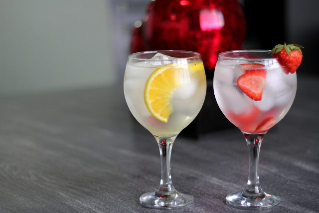 Lemon & Strawberry Flavoured Gins in glasses with ice