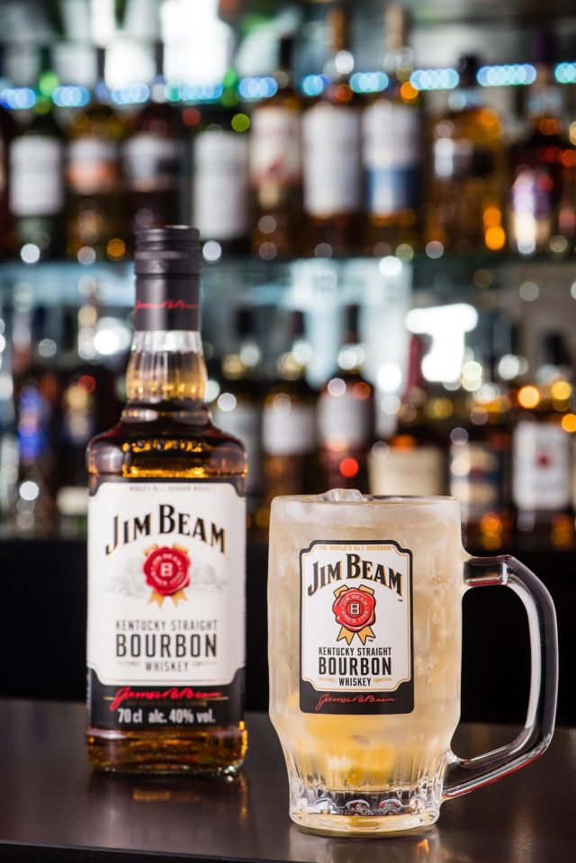 Jim Beam Ginger Highball Whisky Cocktail with a bottle of Jim Beam