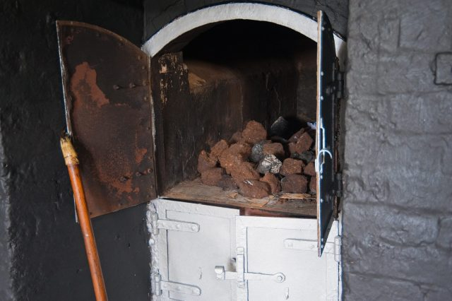 Peat drying in an oven with the doors open