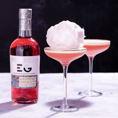 Edinburgh Gin Raspberry Gin Cocktail in a Martini Glass with cotton candy on top