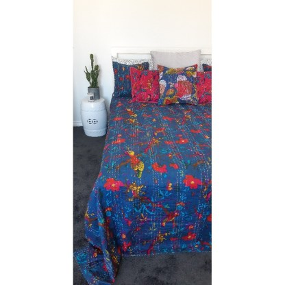 boho blue and pink bedding with side table