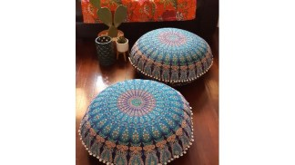 bohemian living room with pair of round floor cushions throw rug and cushions