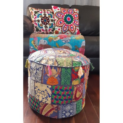 colourful patchwork footstool in front of couch